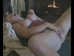 Chubby chick masturbating both holes