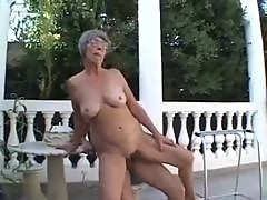 Granny plays with old and young outdoors