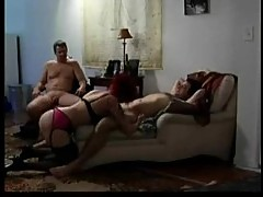 Husband watches wife suck younger man's cock