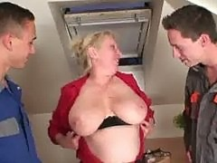 Two repairmen bang busty grandma from both ends