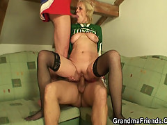 Old whore is filled with two dicks