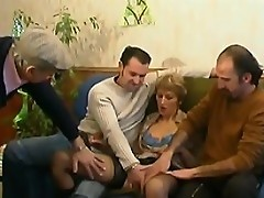 Mature blonde slut takes on three dudes