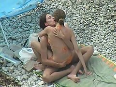 Young horny nudists having sex on the beach