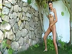 Extremely Hot Teen Poses Naked In Front Of A Huge Stone Wall