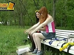 Friends pissing on a bench