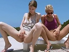 Two hot chicks peeing together on terrace