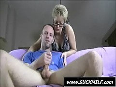 Short haired MILF in glasses gives blowjob