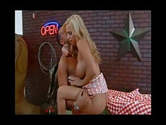 Blond cowgirl with big tits fucking in bar