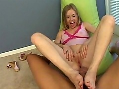Young blonde giggles as her toes gets sucked