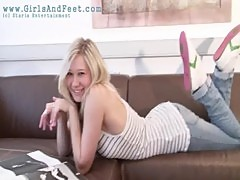 Young girl Nadine removing socks
